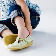 Once your baby starts getting around on her own two feet, the absolute best shoes for her are no shoes at all: When she's barefoot, her tiny toes can grip the floor, giving her tootsies a total workout. But since her feet will need to be protected when she's outside, here are some key things to know about buying toddler shoes.