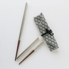 Made from stainless steel and wood, these sturdy reusable chopsticks can be broken into two parts each to fit in a little cloth carry bag. Stainless Steel Containers, Love List, Biomes, Chopsticks, Cloth Bags, Happy Things, Carry Bag, Stuff To Buy, Zero Waste