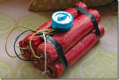 So I made some faux dynamite using paint rollers covered in tissue paper. I spray painted them red, then added black electrical tape, gold metal bolts, some colored wires and even a timer.