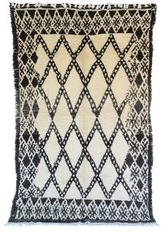 Tribe: Beni Ouarain Code: B153 Size: 6×9'7 Fiber: Wool & Cotton Pile: Short…