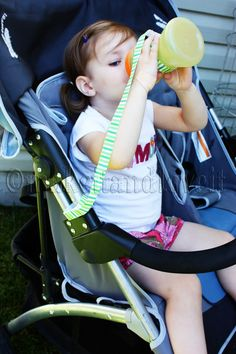 """HOW TO MAKE A SIPPY STRAP: Kids love to trow things, but now you can keep a """"short leash"""" on their sippy cups!"""