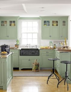 kitchen cabinets and carved soapstone sink