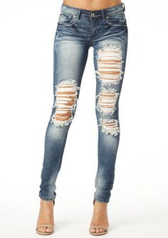 STRETCH five-pocket low rise skinny jean with heavy destruction, contrast stitch, heavy sanding and back patch pockets.