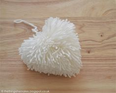 Create a Pom Pom Heart with this easy DIY with the help of something you have hanging around at home! Craft Stick Crafts, Crafts For Kids, Diy Crafts, Fabric Crafts, Sewing Crafts, Sewing Tutorials, Pom Pom Rug, Pom Pom Crafts, Heart Crafts