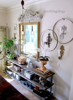 Love that light hanging from the pulley the pediment type piece above the mirror ~ great look ~ from Anythingology: DIY Industrial Shelves