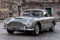 Aston Martin revealed the four classic cars that'll appear in the next James Bond flick 👀Check 'em out at the link in bio. Aston Martin Db5, Classic Aston Martin, Retro Cars, Vintage Cars, James Bond Cars, Classy Cars, Classic Motors, Sport Cars, Cars And Motorcycles