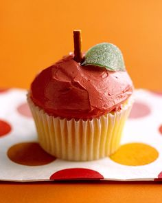 """.:* L - Apple Cupcakes - Martha Stewart Food [""""Apple Cupcake How-To The teacher will have a soft spot for a little scholar whose September birthday brings these scrumptious apples to her classroom. Lots of thick icing forms the rounded shape, and each gets a pretzel stem and a leaf cut from sour tape.""""]"""