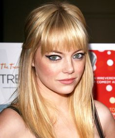 Emma Stone: Round Emma Stone's bangs hit right at her brows -- just high enough to stay out of her eyes and give her a fresh look that balances her face. The best part about this style: The awkward-grow-out phase is considerably shorter because as it gets further away from your cut, your bangs hit the pretty, lash-grazing length (more on those in a second).