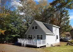 $149,900 SWEET and LOW Centrally located with close walk to Deer Lake fishing, boating and swimming. This easy care Chalet built for enjoyment, has newer 3 dimensional roofing shingles, the warmth of a wood burning full hearth stone faced fireplace and bright windows to enhance open floor cathedral ceiling. http://www.flexmls.com/share/18H5K/1018CottageLnLakeArielPA18436