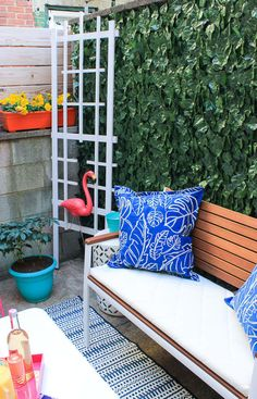Fake ivy is great for concealing ugly chain link fence or even just making a balcony feel more like a fancy garden. Learn more here.Get 84 feet of fake ivy from Amazon for $14.75.