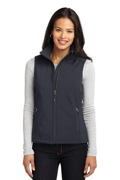 The Port Authority® Ladies Core Soft Shell Vest is 100% polyester woven shell bonded to a 100% polyester microfleece lining. Reverse coil zippers and zip-through cadet collar with chin guard. Front zippered pockets and open hem.  1000MM fabric waterproof rating  1000G/M2 fabric breathability rating