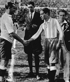Uruguay 4 Argentina 2 in 1930 in Montevideo. The captains, Jose Nasazzi and Manuel Ferreira, shake hands before the World Cup Final.