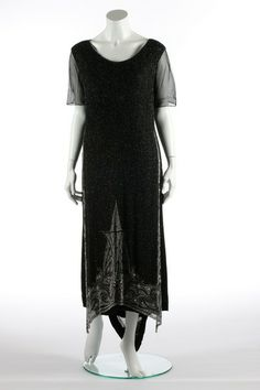 One Item | Kerry Taylor Auctions An Haute Nouveaute de Paris flapper dress, circa 1928. purple on white woven label, the black chiffon ground covered with graduated stripes in matt-gold sequins, with sequined and beaded three dimensional poppies to the hem, bust 102cm, 40in; together with a poor condition beaded black tulle full length gown c.1925 with fabulous deco-beaded hem (2). - See more at: http://kerrytaylorauctions.com/one-item/?id=47&auctionid=401#sthash.7s6pPpXe.dpuf