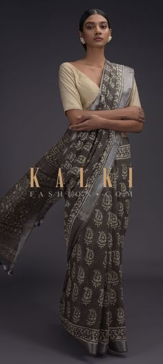 Buy Online from the link below. We ship worldwide (Free Shipping over US$100)  Click Anywhere to Tag Ash Grey Saree In Linen With Batik Printed Buttis And Zari Weaved Border Online - Kalki Fashion Ash grey saree in linen with batik printed buttis and zari weaved border.Pallu trimmed with thread tassels. Grey Saree, Plain Saree, Batik Prints, Ash Grey, Printed Sarees, Designer Sarees, Silk Sarees, Tassels