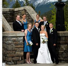 The bride, clad in a silk gown with an Empire waist and a sweetheart neckline, selected blue knee-length dresses with silver sandals for her three bridesmaids. The groom and his three groomsmen sported classic black tuxedos with silver ties.