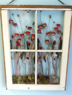 This one is more like a shadow box. Use a window with a deeper frame and set in moss and dried flowers. This would be a great way to preserve a wedding bouquet or flowers from a special occasion.