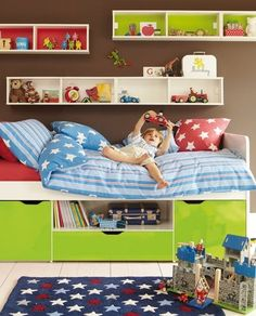 More boys room ideas.... by Errikos Artdesign ... think cd racks. May work better than shelf, especially for Dylan.
