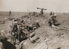 This picture is part of a previously unpublished set of World War One images    from a private collection. The photographs offer an unusual view of varied    and contrasting aspects of the conflict, from high tech artillery to mobile    pigeon lofts, and from officers partying in their headquarters to the grim    reality of life and death in the trenches. Above, British troops advance    during the battle of the Somme in 1916.