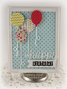 """HandKrafted by Stephanie—TE Up, Up, & Away Cutting Plate. The plate also comes with balloon dies to make piecing the balloons easy. A blue vellum polka dot background is pieced with the patterns from the Double the Fun paper pack. The """"happy"""" die cut is from Think Happy (this month's incentive set) and """"birthday"""" is from Little Bits of Birthday."""
