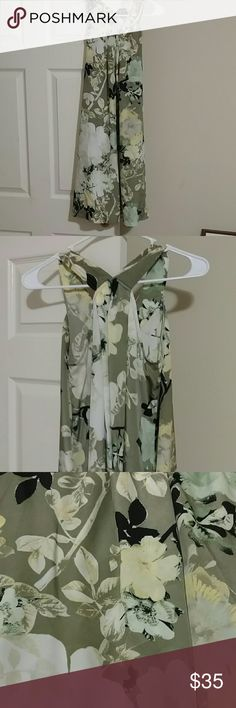 New York and company dress New York and company dress size small olive green with floral pattern and open v back with side pockets New York & Company Dresses