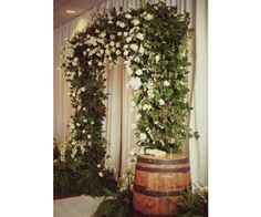 The lush arbor included ferns, lilies, monkey tails, white snapdragons, and garden roses.