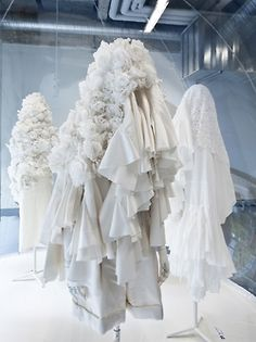 White Drama - An exhibition of the Comme des Garcons Spring 2012 collection presented at Les Docks-Cité de la Mode et du Design, Paris. After seeing Comme des Garçons' emotive runway show, museum curator Olivier Saillard gave CDG's Rei Kawakubo carte blanche to reinterpret the collection for a static environment. She's presenting her clothing brand's pure-white ceremonial collection – which dramatizes birth, marriage and death – within a series of transparent domes. An intriguing set of…
