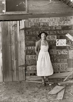 "Truck Farm: November 1938. ""Farm woman beside her barn door. Tulare County, California. No more horseshoes!"" Medium-format nitrate negative by Dorothea Lange"