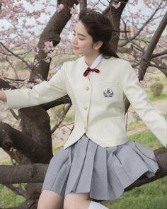 Cute Asian school girl on Sakuratree 🌸