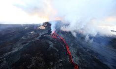 Lava flows out of the Piton de la Fournaise volcano as it erupts on May 17, 2015 on the French island of La Reunion in the Indian Ocean. The Piton de la Fournaise started to erupt early on May 17, with its last eruption dating back to February 4. AFP PHOTO / RICHARD BOUHETRICHARD BOUHET/AFP/Getty Images