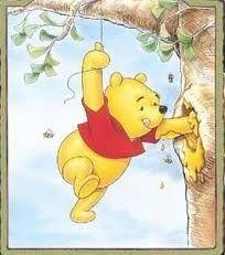 Winnie the pooh getting his honey!