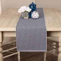 The 13x90 Tara Navy Ribbed Runner is a noteworthy addition to Americana tabletop settings. Designed with the collection in mind, the navy and white gingham checks of the 13x72 Tara Navy Ribbed Runner coordinates excellently with the solid navy on the napkins.Features PREMIUM CONSTRUCTION: with over two decades experience crafting goods for American homes, our items are built to last for years to come. FARMHOUSE DECOR: fits your farmhouse home with updated country style. QUALITY MATERIAL… Country Style Curtains, Country Decor, Farmhouse Decor, White Burgundy, Navy And White, California King Quilts, Fox Decor, Traditional Furniture, Bath Decor