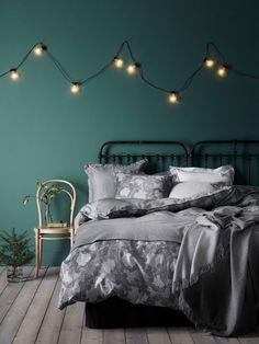 Elegante y actual dormitorio pintado en verde