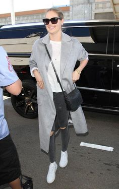 Kate Upton has the perfect airport outfit to copy: Pull on comfy skinny jeans, flat sneakers, a t-shirt, and a long, tailored coat. It's comfortable but still pulled-together.