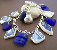 Charm bracelet made with genuine surf tumbled sea glass and sea pottery on sterling chain and sterling sea shell. For the beach lovers. Stone Street Studio