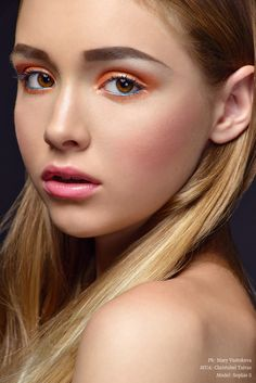 Tangerine eyeshadow - in my opinion the best colour eyeshadow out there, it makes blue and green eyes pop, and brown eyes glow. It suits everyone from ivory to blue-black skin and it's so fresh and unexpected