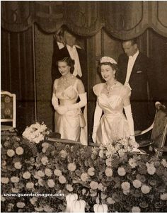 Queen Elizabeth, her sister, Princess Margaret, and husband the Duke of Edinburgh, taking their seats in the Royal Box for the Royal Variety Performance, 1954.