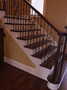 Wrought Iron Staircase Design Ideas, Pictures, Remodel and Decor Wood Railings For Stairs, Wrought Iron Stair Railing, Stair Railing Design, Wood Staircase, Staircase Remodel, Staircases, Iron Spindles, Iron Railings, Banisters