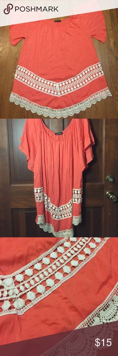 ORANGE CARAMEL ORANGE LACE TOP/TUNIC | Size 3XL This is a top from a boutique. Name brand is Orange Caramel. It is a short tunic length and has intricate lace detailing on the bottom of the front. It does have one snag in the fabric on the left sleeve and one of the lace details has come unattached from the side of the shirt (pictures are included in both. It is a beautiful orange color and has flowy sleeves. Do note that the lace details are unlined, and may require an undershirt. Orange…