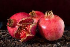Fruit - Still life with ripe Granada in the bark of trees.