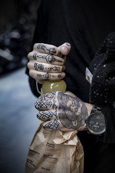 symbolic finger and hand tattoos