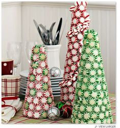 Stonewall Kitchen - Peppermint Trees 1. Purchase different sizes of white styrofoam cones at a craft store. 2. Unwrap round peppermint candies. 3. With a glue gun, attach the candy to the cones and create your own winter candy land.