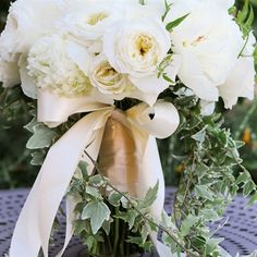 Ivory Bouquet with peonies and garden roses in a soft shade of ivory filled Sara's bridal bouquet. Cascading ivy framed the bouquet, adding a whimsical touch and hint of color