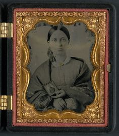 Unidentified woman holding a cased photograph of an unidentified soldier in…