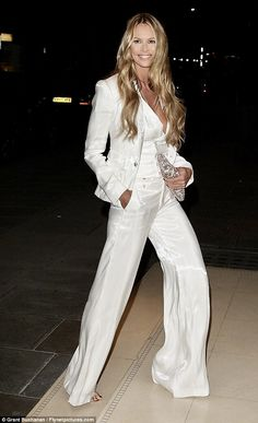A flare for fashion! Elle Macpherson opts for androgynous chic as Whitney Port channels her inner Grecian goddess in gold toga Wish I could rock this look :) ~ Elle Macpherson (age ~ Rodial Beautiful Awards in London ~ March 2012 Elle Macpherson, Celebrity Outfits, Celebrity Style, White Pantsuit, Wedding Pants, Best Street Style, Grecian Goddess, White Suits, White Pant Suit Women
