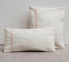 these would be pretty simple.  Just make a white pillow and hand-stitch the lines with embroidery thread.