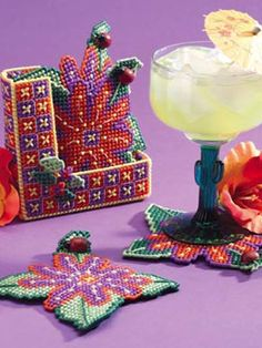 You'll have plenty of opportunity to practice a basic stitch with this four-piece coaster set and holderSkill Level: Intermediate