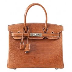 7c185d47504 View this item and discover similar top handle bags for sale at -  Guaranteed authentic rare matte Fauve Barenia Hermes Birkin 30 bag.