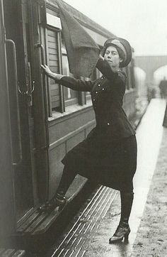 Female Conductor on the Metropolitan Railway, 1916.  Those boots!  from http://shoeblogs.com/2011/01/07/metropolitan-railway-boots/