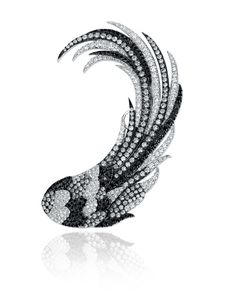 Colette ear cuff in 18k gold with 3.68 cts. t.w. gray diamonds, 3.06 cts. t.w. colorless diamonds, and 2.17 cts. t.w. black diamonds; $15,350 #Colette #gold #diamonds