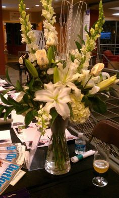 tall vase arrangement - all whites - can translate easily to top a large cylinder for ceremony area. Design by Flowers by Jennie Lynne